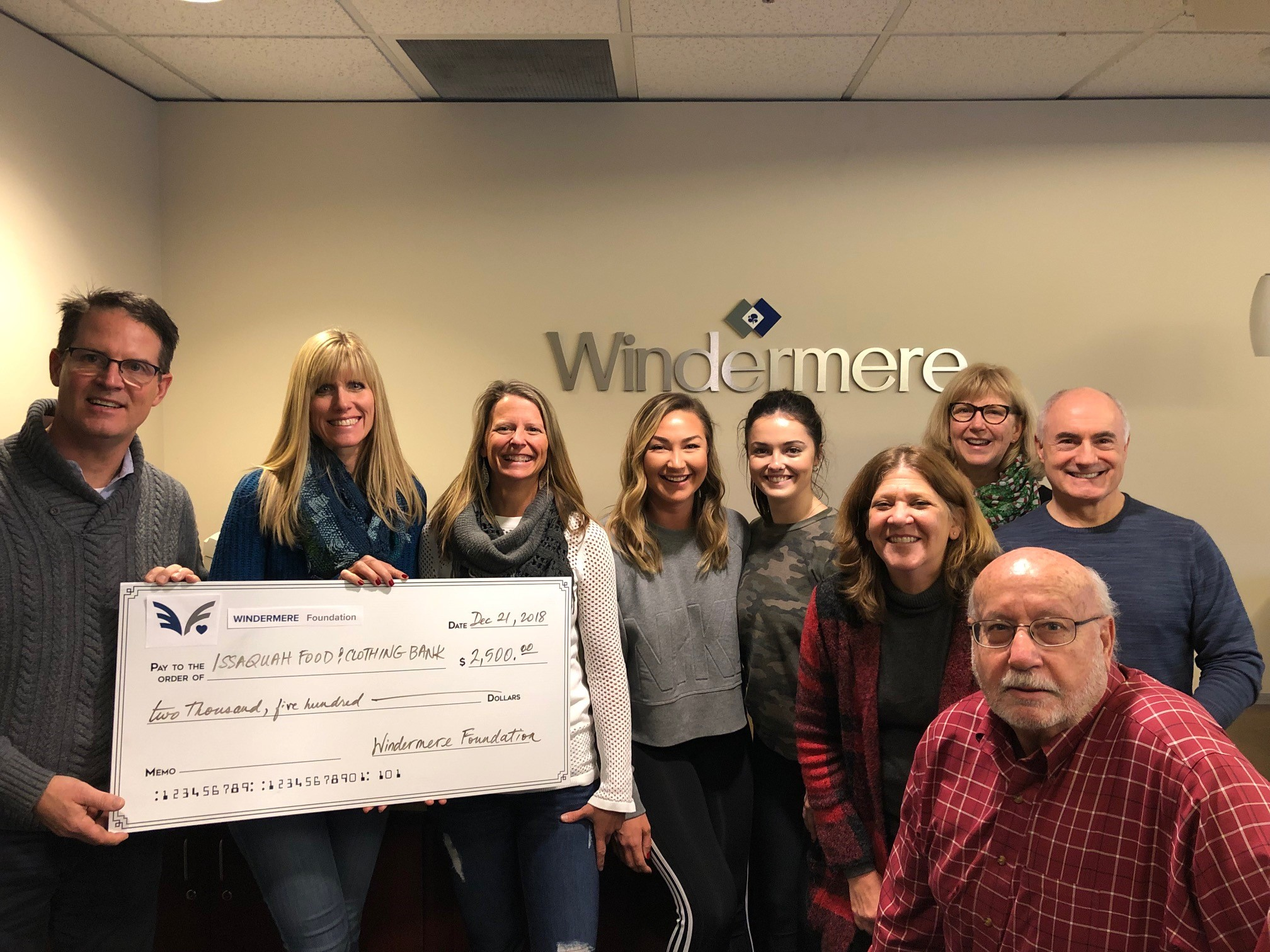 The Windermere Foundation presents the Issaquah Food Bank with a check for $2,500.00