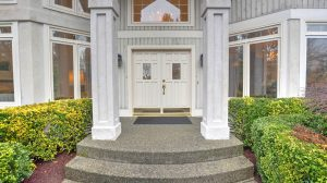 An elegant double door entry opens to a gorgeous foyer with an 18' ceiling. Vertical wood siding along with real stucco accents plus a cement tile lifetime roof encase the home beautifully. The grounds of the home burst with color most of the year and provide privacy....